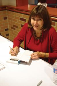 Zach Dorsch photo: Jean Kilbourne, Ed.D., took time to sign her books following her presentation at Tuesday's event.