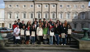 Students stop for a picture in front of the Irish House of National Parliament.