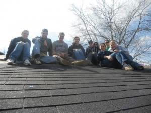 Contributed photo: Students pose for a picture on the roof during the Habitat for Humanity spring break trip.