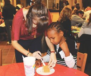 Sarah Hlusko photo: An estimated 94 children took part in Christmas on Campus.