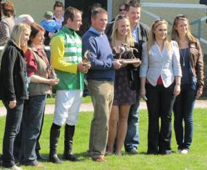 Students, along with Dungarvan's mayor and his wife, hand the winning jockey of the horse race his trophy. Students include Caileen Farrell, Melissa Kirwin and Sarah Hricko.