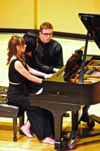 Zach Dorsch photo: Senior Kelton Macke performs a piece with Shirley Yoo, Ph.D., during Thursday's faculty recital.