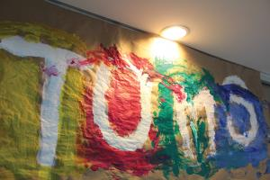 Taylor Rollins photo: TOMS paints a mural with a variety of colors to show off what it is all about.