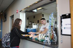Taylor Rollins photo: Sam Strathern gets an order from hospitality student Bobby Spoden at Café Diem, which opened its doors to students this past week at the first floor lobby of the Center for Academic Excellence.t