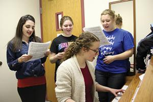Taylor Bookmiller photo: Chelsea Cool, Brianna Carle, Tonya Lenhart, and Bethany Sulecki practice for the 2nd annual Winter Cabaret that is being held on Wednesday, Feb. 26 at the Taylor Little Theatre.