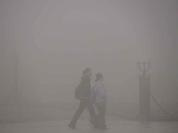 Merciad photo: Students walk to class through a thick layer of fog Thursday, April 7, 2011, at Mercyhurst College.