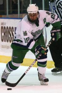 Senior Cody Collins advances the puck as the Lakers press the offensive attack.