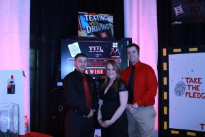 Jill Barrile photo: Junior Craig Small and seniors Lindsay Dorrion and Patrick Ellement created TTYL for the Tradeshow.