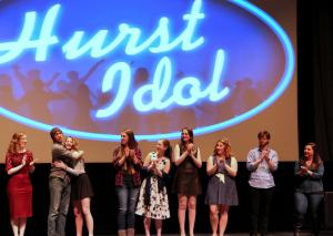Nhi Tran photo: Participants at SAC's third annual Hurst Idol learn the results after the audience texted their votes for their favorite performance. Dhedra Danudoro and Eva Sullivan embrace as they are awarded the title.