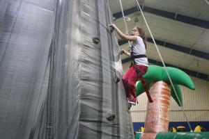 Ashley Favata photo: Rock wall climbing occurred in the REC during Kids and Sibs.