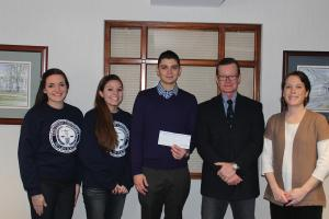Contributed photo: Students Alyssa Ross, Megan Helton, Jake Jakiewicz, LAVA Attorney David Baxter and club adviser Meredith Bollheimer pose for photo after the donation was presented to LAVA.