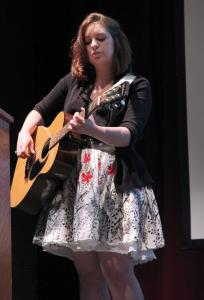 Jill Barrile photo: Senior Angelina Smith performed original work for the presentation of Lumen during the Literary Festival.