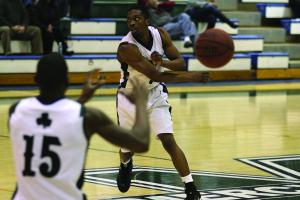 The Mercyhurst College junior guard Jamal Turner makes a no-look pass in the Lakers' 92-66 victory over Lake Erie College.