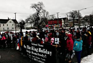 Nhi Tran photo: People of all ages marched in downtown Erie in freezing temperatures in honor of Martin Luther King Jr. Day this past Monday, Jan. 19.