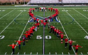 Contributed photo: Members of the Colleges Against Cancer club gathered at Tullio Field to capture the photograph appearing on the holiday cards.