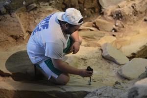 MAI photo: A student in the archaeology department helps repair Meadowcroft Rockshelter during late summer.