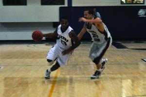 Mercyhurst College junior Jason Snow dribbles past a Virginia Union defender in the Lakers 73-61 victory.