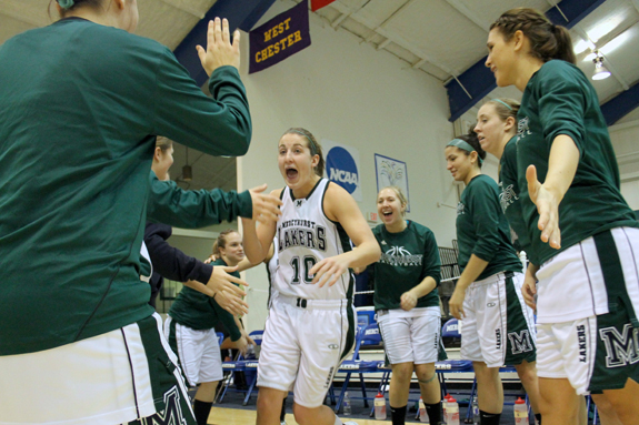 Photo by Ethan Magoc: Mercyhurst College senior Samantha Loadman yells as she high fives teammates during pregame introductions before a game against Clarion University on Wednesday, Jan. 19, 2011, at the Mercyhurst Athletic Center.