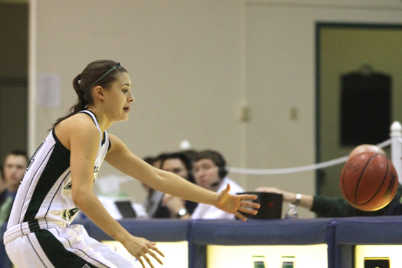 Photo by Ethan Magoc: Mercyhurst College sophomore Dana Banda reaches for a loose ball near the scorer's table during the first half against Clarion University on Wednesday, Jan. 19, 2011, at the Mercyhurst Athletic Center.
