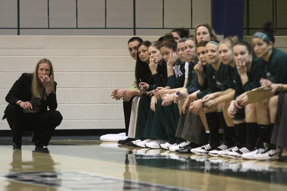 Photo by Ethan Magoc: Mercyhurst College coach Deanna Richard and her players watch the first half action against Clarion University on Wednesday, Jan. 19, 2011, at the Mercyhurst Athletic Center.