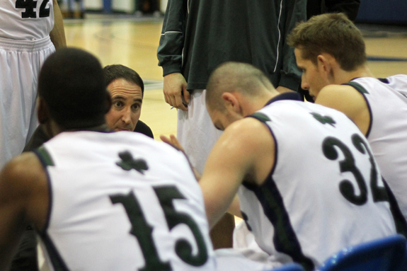 Photo by Ethan Magoc: Mercyhurst College coach Gary Manchel discusses a play with his team during a second half timeout against Clarion University on Wednesday, Jan. 19, 2011, at the Mercyhurst Athletic Center.