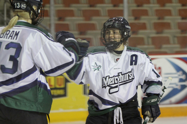 Photo by Ethan Magoc/The Merciad: Mercyhurst College's Vicki Bendus and Bailey Bram celebrate Bendus' shorthanded goal in the second period that gave the Lakers a 4-0 lead against Brown University on Friday, Jan. 28, 2011 at Tullio Arena.