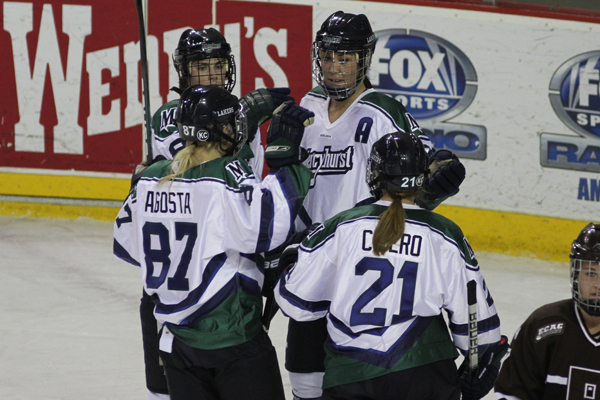 Photo by Ethan Magoc/The Merciad: Mercyhurst College's Meghan Agosta, Melissa Lacroix, Jesse Scanzano and Christie Cicero celebrate Cicero's goal in the first period on Friday, Jan. 14, 2011 at Tullio Arena.