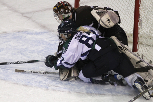 Photo by Ethan Magoc/The Merciad: Mercyhurst College's Meghan Agosta collides with Brown University goaltender Katie Jamieson during the first period on Friday, Jan. 14, 2011 at Tullio Arena.