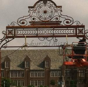 Contributed photo: The gates marking the entrance to Mercyhurst University are receiving a face lift which includes a new paint job as well as branding the landmark with the name of the college.