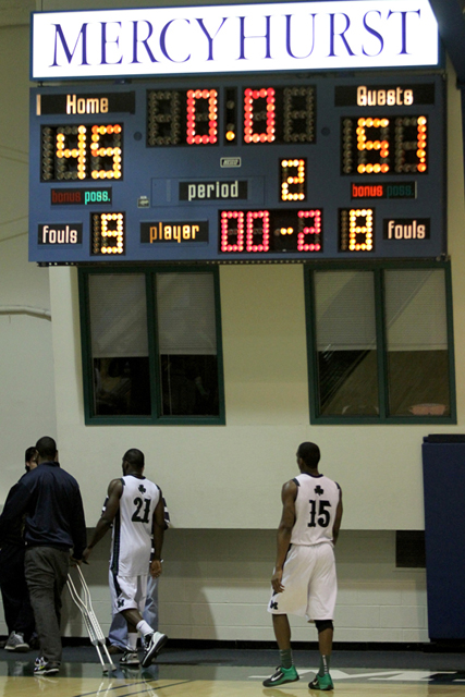 Ethan Magoc photo: Mercyhurst College's Olivier Dupiton, holding crutches, Bryheem Charity (21), and Shelton Jackson (15) walk off the court following their team's 51-45 loss to Slippery Rock on Tuesday, March 1, 2011 at the Mercyhurst Athletic Center.