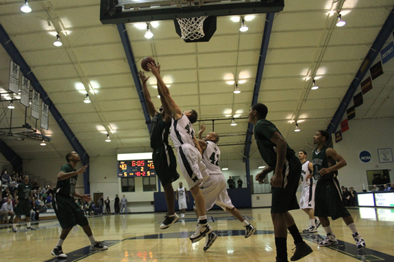 Ethan Magoc photo: Mercyhurst College's Iddo Cohen (44) fights for a rebound during the second half against Slippery Rock on Tuesday, March 1, 2011 at the Mercyhurst Athletic Center.