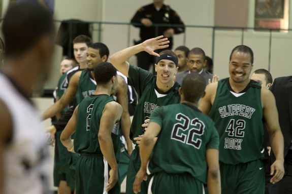Ethan Magoc photo: Slippery Rock's men's basketball team celebrates its upset PSAC playoff win against Mercyhurst College on Tuesday, March 1, 2011 at the Mercyhurst Athletic Center.