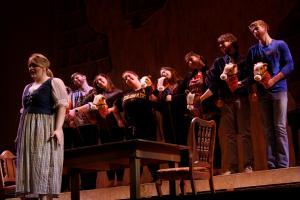Ashley Favata photo: Senior Kathleen Reveille plays Cenerentola as the chorus announces the arrival of Prince Ramiro.