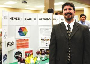 Sarah Hlusko photo: Professor of Public Health David Dausey, Ph.D., at the Major and Minors Fair on Wednesday, Oct. 19.