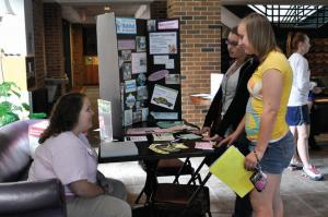 Tyler Stauffer photo: Freshmen Emily Salone and Andrea Lisowski spoke to Britney Cerrie from Habitat for Humanity at the Service Fair on Wednesday, Sept. 9. The annual Service Fair informs Mercyhurst students about volunteer opportunities in Erie.