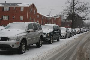 Ashley Favata photo: Cars parked on Briggs Ave. get their windows covered with snow.