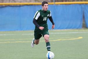 Ryan Lund dribbles downfield in the Laker's match against Lynn University.: Sydney Cuscino photo