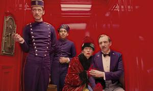 "ew.com photo: Wes Anderson's latest film, ""The Grand Budapest Hotel"" has a combination of action, comedy and drama that makes sure that every detail is executed to perfection."