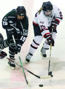 Sophomore defenseman Stephanie DeSutter fights for the puck.