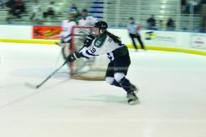 Tyler Stauffer photo: Freshman Stephanie DeSutter clears the puck from the Lakers defensive zone.