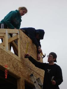 Senior Chelsey Crawford and juniors Joe Krajcik and Kevin Finn work on the roof of a house in New Orleans.
