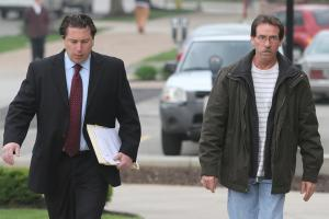 Ethan Magoc photo: Wayne Johnson Jr., Peters' publicly appointed attorney, and Allen Francis Peters walked into the Erie County Courthouse today for Peters' sentencing.