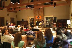 Contributed photo: Junior Meghan McNamara played guitar and sang for a crowd of students at AmnesTEA on Thursday, Jan. 14.