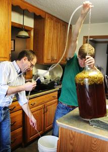 Sarah Hlusko photo: Spacht and his father work together to make their own beer.
