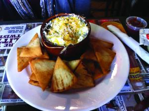 Liz Zurasky photo: Calamari's offers an artichoke dip appetizer.
