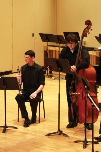 Jill Barrile photo: Freshmen Ethan Dovensky and Beau Miller perform a selection by Freshman Luke Allport-Cohoon.