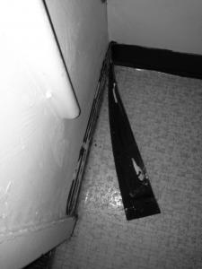Contributed photo: Students have also found that rubber moldings in their rooms are falling off the walls.