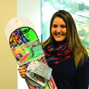 mercyhurst.edu photo: Kaitlin Badger takes a photo with her new Target snowboard design.