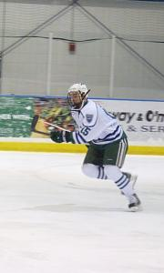 Junior Kyle Just skates down the ice with authority.: Sam Rappi photo