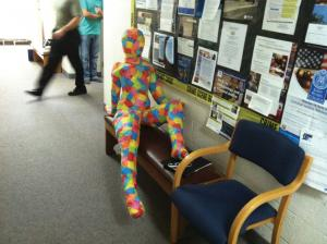Sarah Hlusko photo: The mystery of the mâché man continues, and he is found relaxing in President Gamble's office.